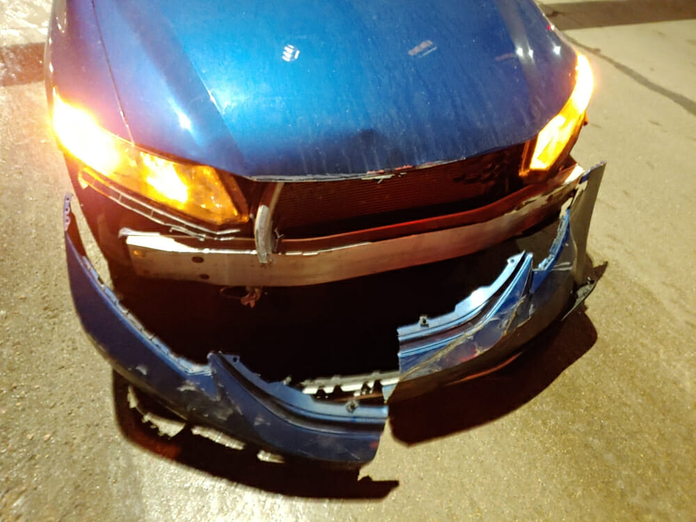 Photo of the front of my 2014 Honda Civic after a collision with the front bumper wrecked.